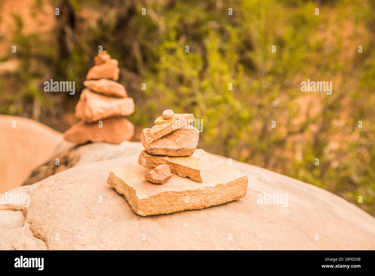 Stone cairns on Park Avenue Trail in Arches National Park Utah USA - Stock Image