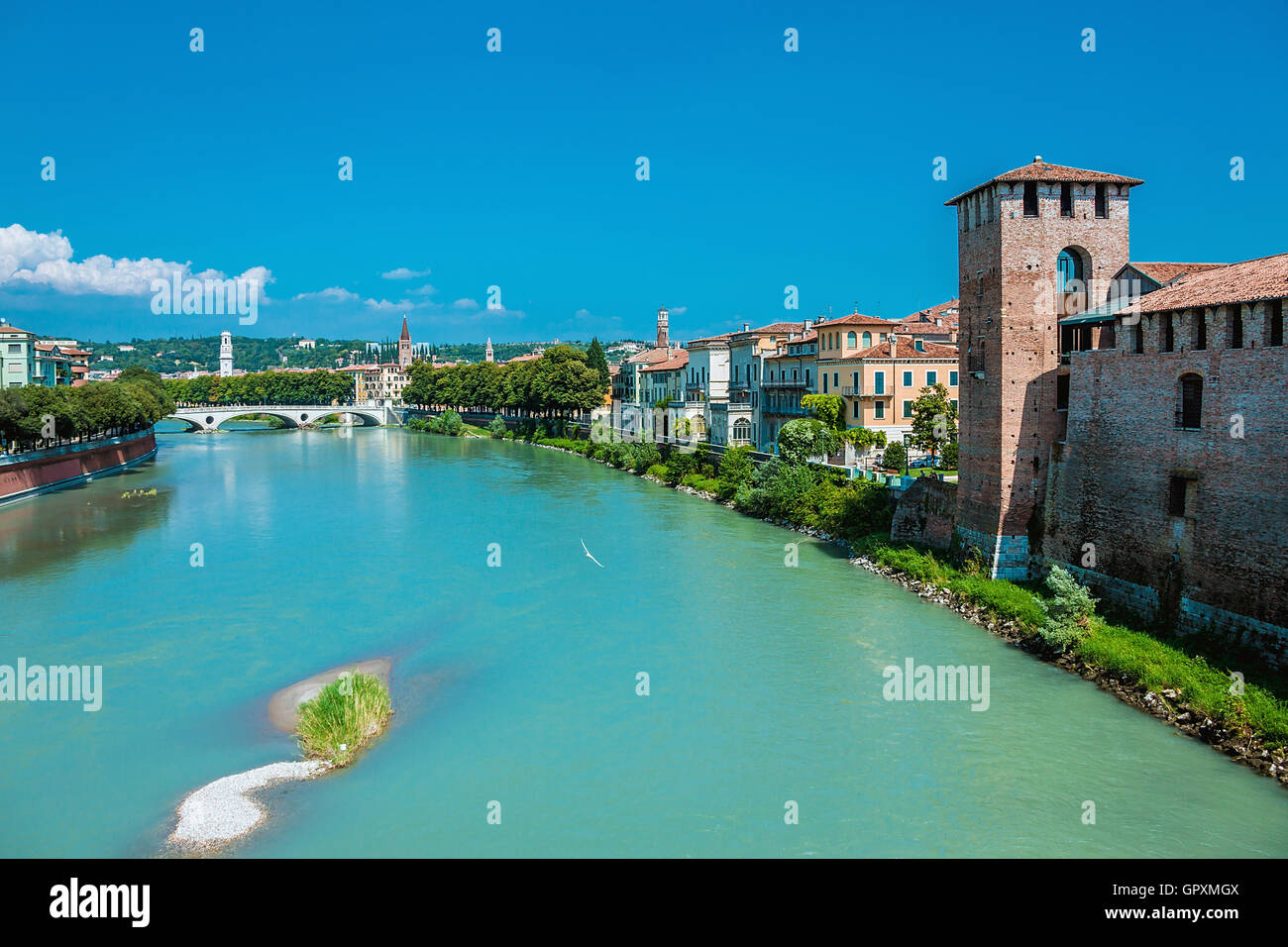 Ponte Pietra on river Adige, ancient roman bridge in the old town of Verona, Italy - Stock Image