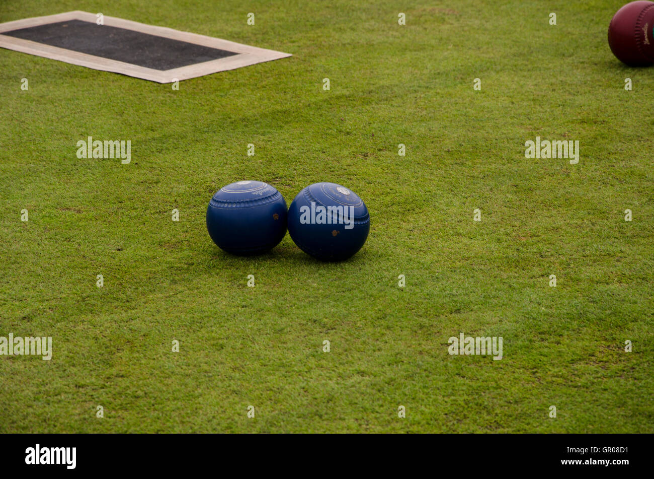 This picture shows some bowling balls and a matt used in Lawn Bowls. Taken on August 20th, 2016 at Portstewart, - Stock Image