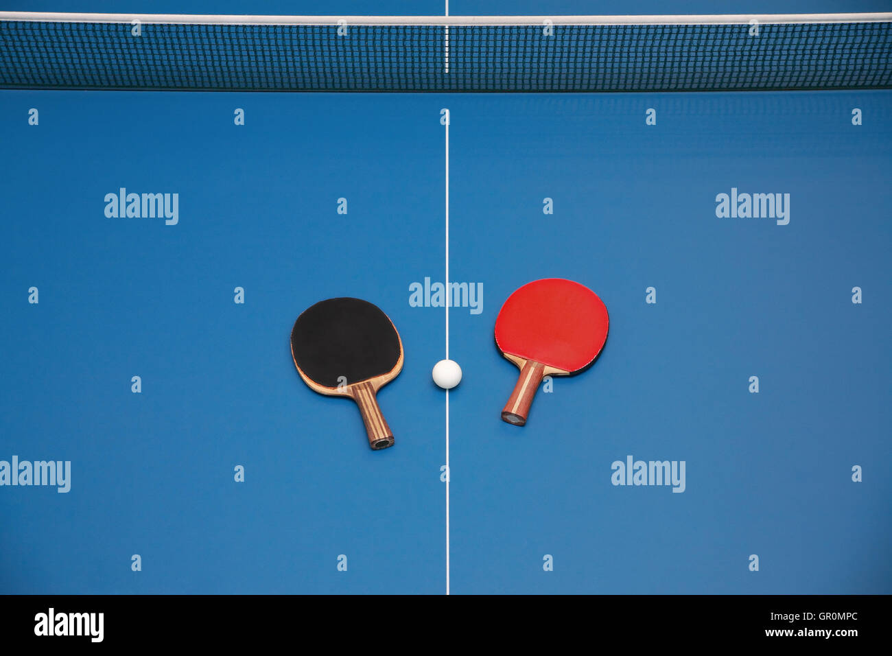 Rackets For Table Tennis Of Red And Black Color And A Ball On A