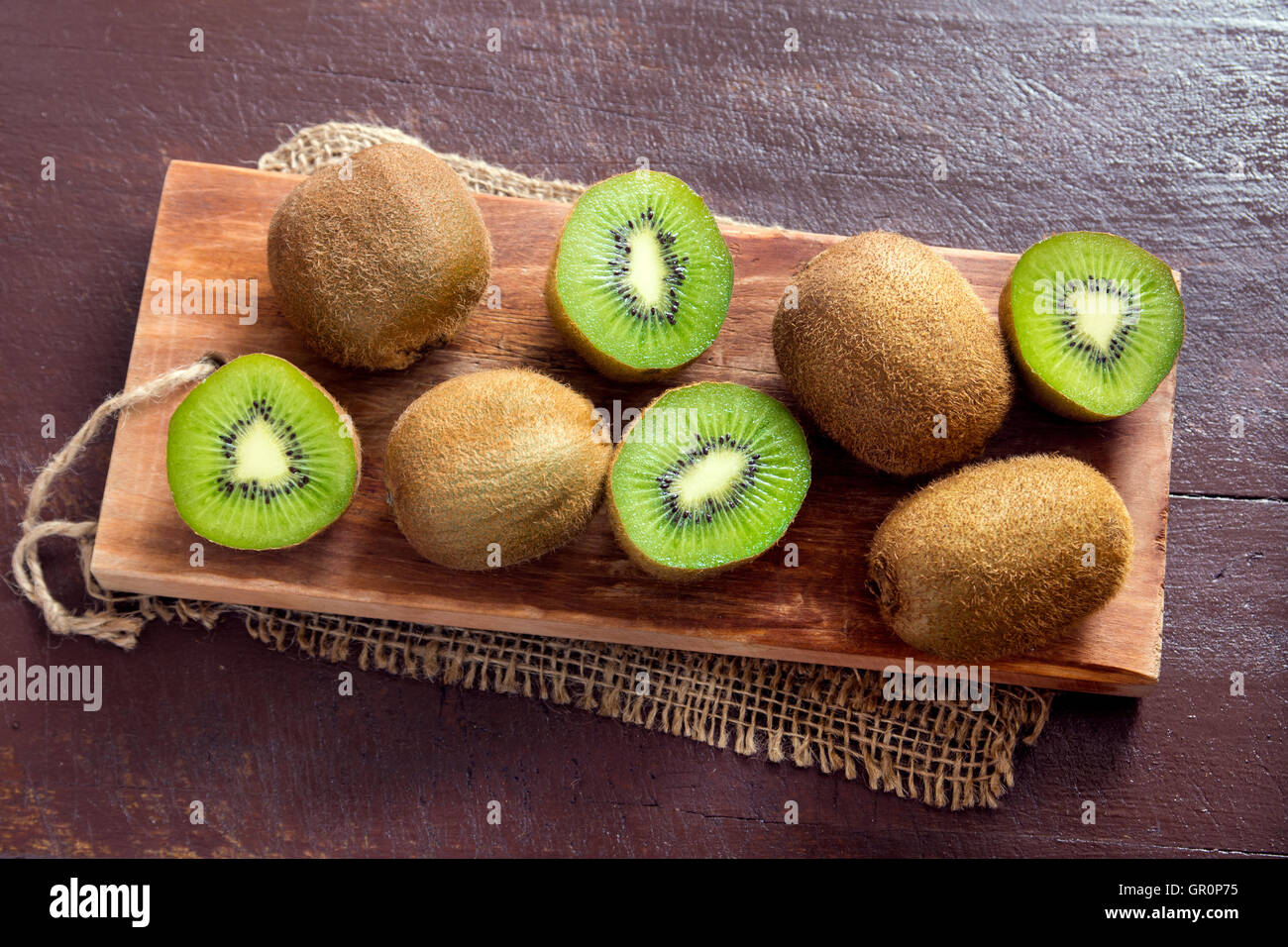 Kiwi fruits on wooden background - Stock Image