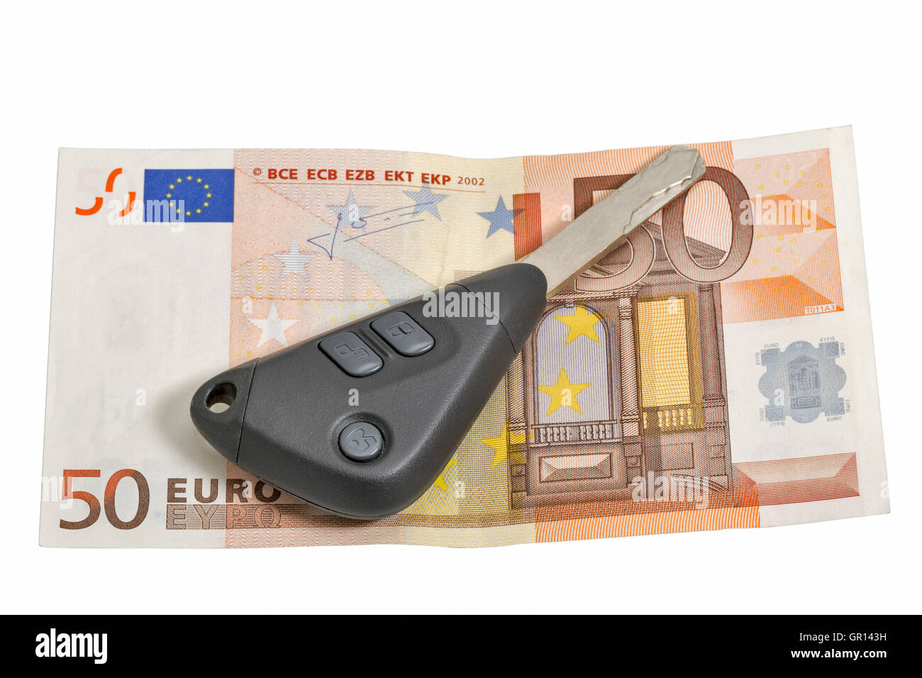 fifty euros banknote and car keys isolated on white closeup with copy space - Stock Image