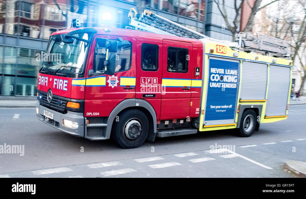 London Fire Brigade engine on call blue light - Stock Image