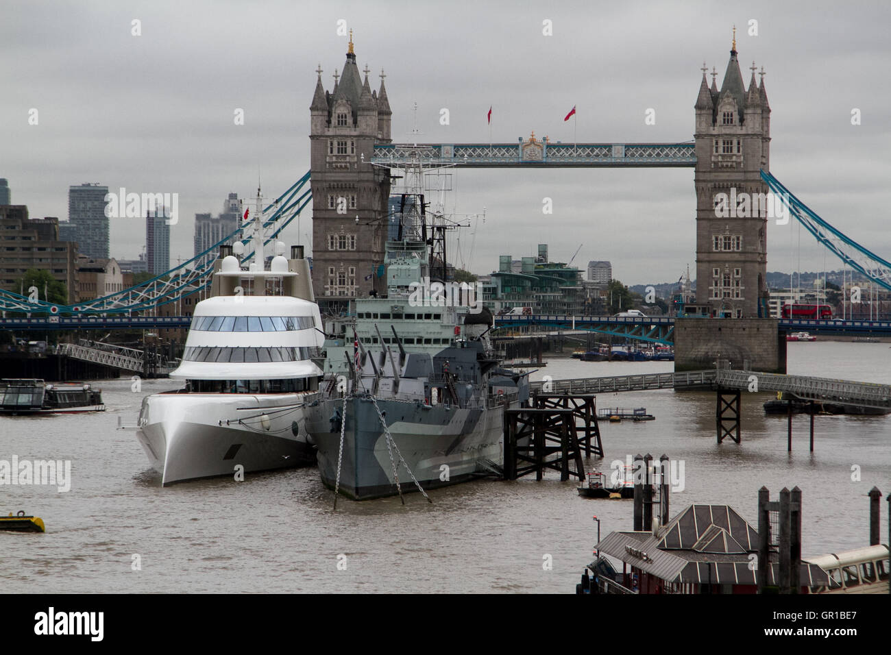 A 300 million dollar superyacht by  Russian billionaire Andrey Melnichenko sailed up the River Thames  to moor alongside - Stock Image