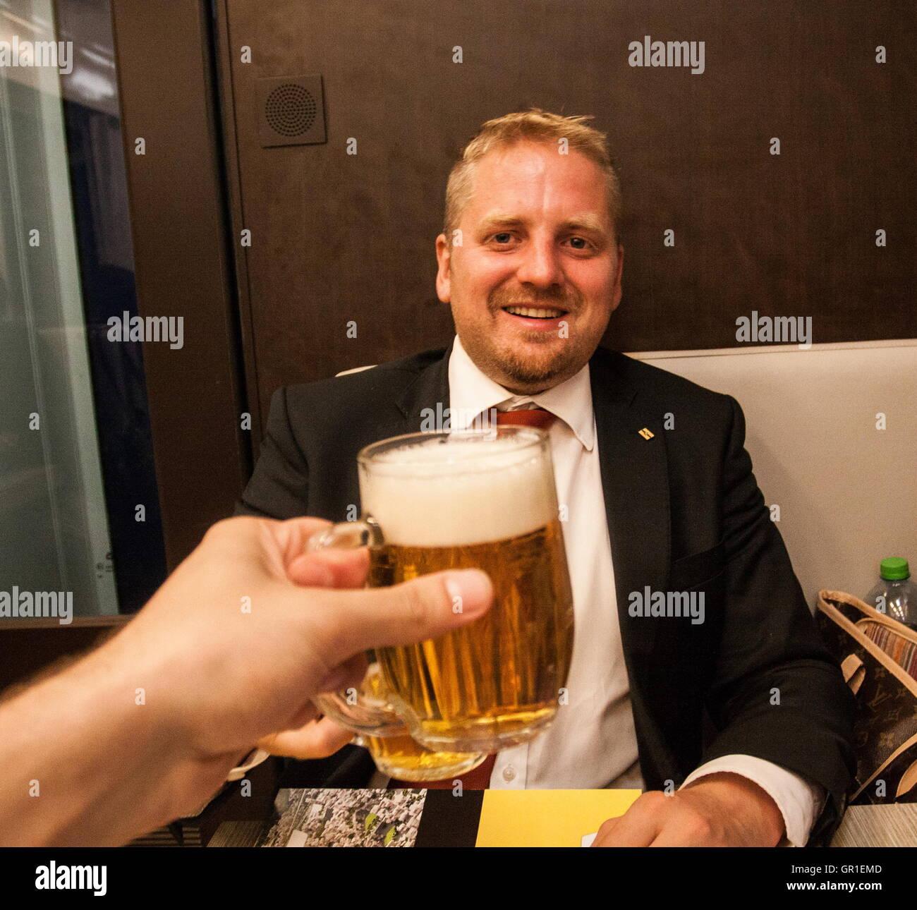 Aug 29, 2016 - Novi Sad, Serbia - Clicking beer glasses with Liberland President VIT JEDLICKA on a train. The Free - Stock Image