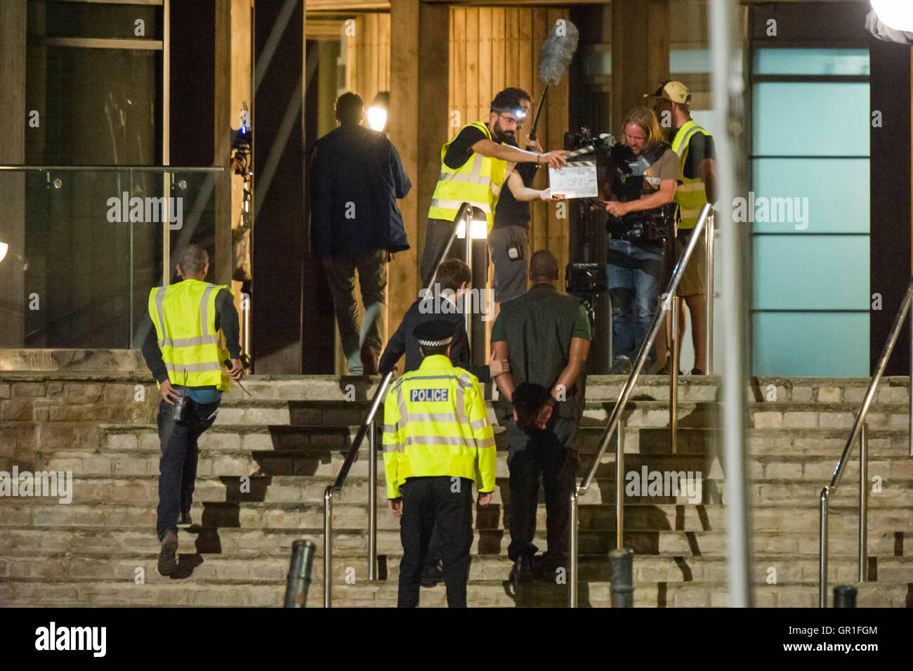 West Bay, Dorset, UK - 6th September 2016 - David Tennant and Sir Lenny Henry filming arrest scene on the steps Stock Photo
