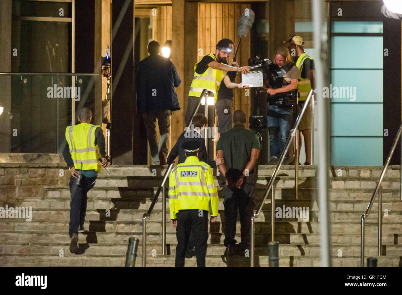 West Bay, Dorset, UK - 6th September 2016 - David Tennant and Sir Lenny Henry filming arrest scene on the steps - Stock Image