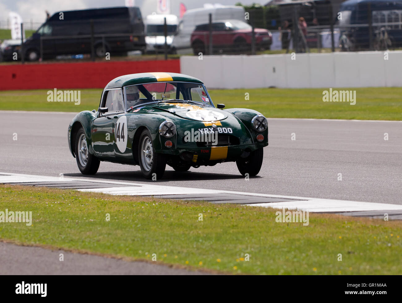 An1958 MGA Twin Can driven by Mark Ellis during a qualification session for the RAC Tourist Trophy for Historic - Stock Image