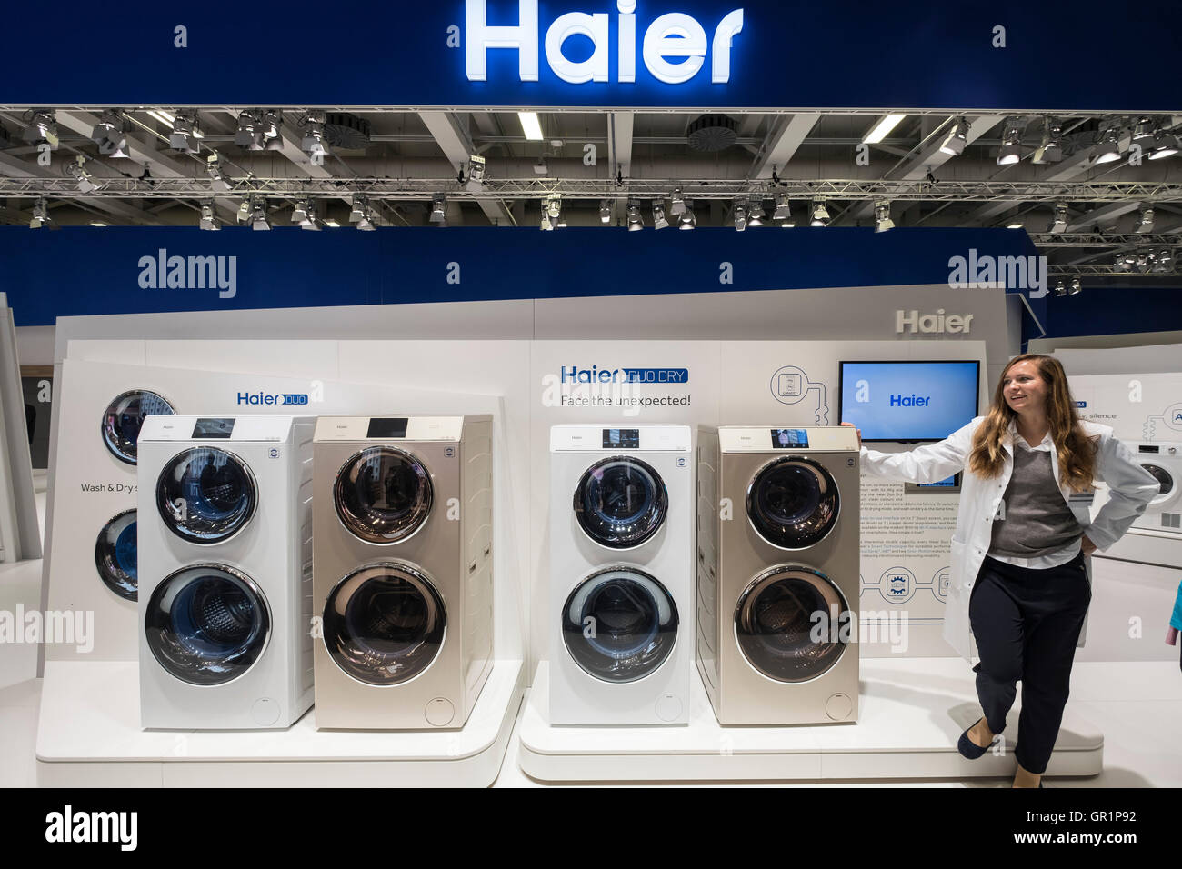 New twin washing machine and dryers by Haier at 2016  IFA (Internationale Funkausstellung Berlin), Berlin, Germany - Stock Image