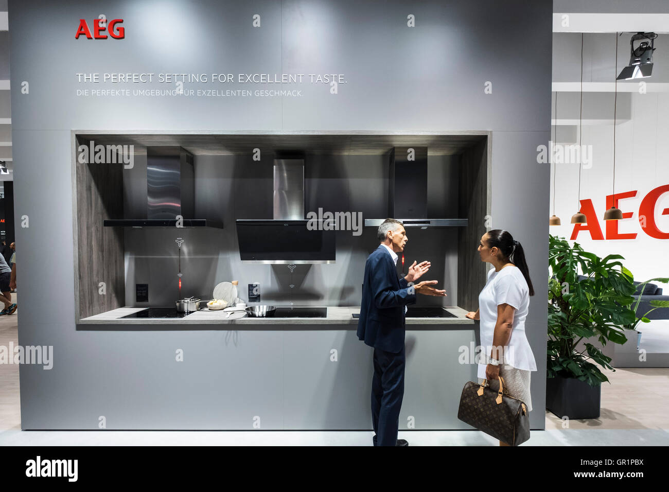 Visitor shown modern AEG cookers at at 2016  IFA (Internationale Funkausstellung Berlin), Berlin, Germany - Stock Image