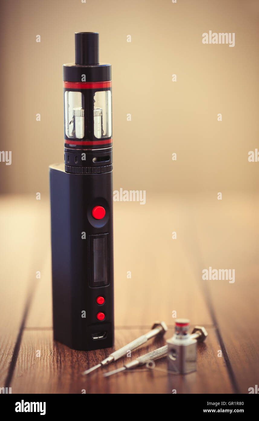 Upgrade parts for modern vaporizer boxmod e-cig device,  spare part with kanthal clapton coil drip. Modern device - Stock Image