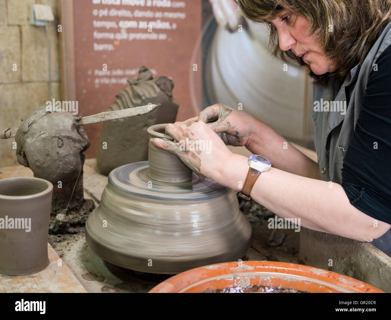 Growing A Tall Pottery Cup From Clay A Woman Worker Spins A Simple Stock Photo Alamy