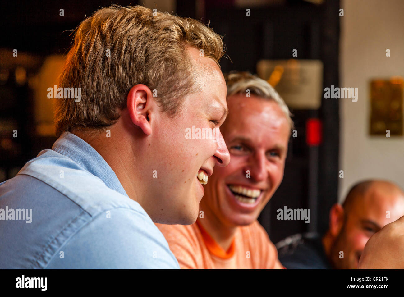 Family Conversations Around The Dinner Table In A Village Pub, Sussex, UK - Stock Image