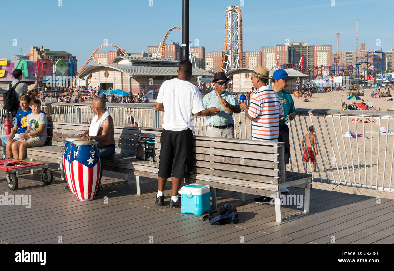 Local percussion musicians performing/ jamming on Steeplechase Pier, Coney Island beach with men playing instruments - Stock Image