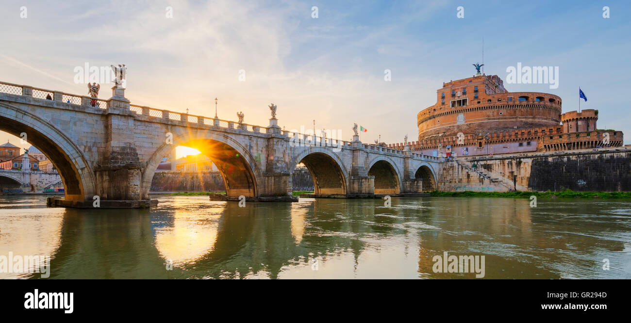 Castle of Holy Angel and Holy Angel Bridge over the Tiber River in Rome at sunset. - Stock Image