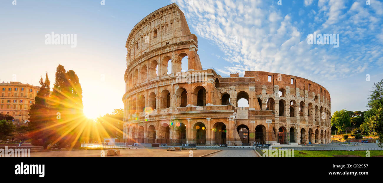 Panoramic view of Colosseum in Rome and morning sun, Italy, Europe. - Stock Image
