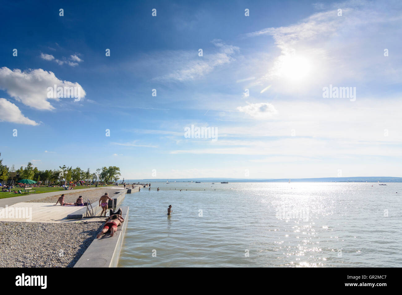Illmitz: public bathing beach lido, Lake Neusiedl, Neusiedler See, swimmer, sailboat, sunbather, Austria, Burgenland, - Stock Image