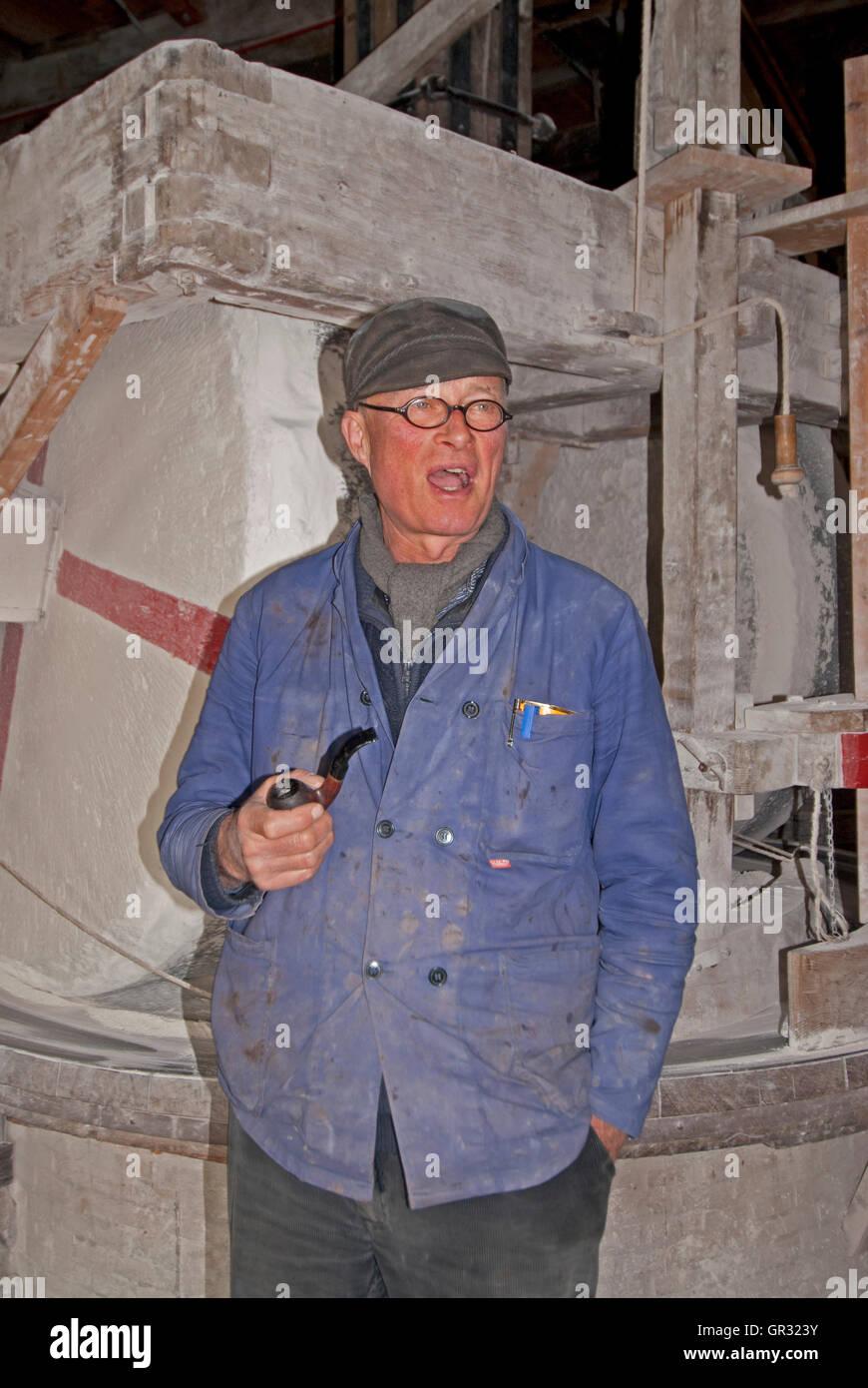 Guide and interpreter, Piel Kempenaar, provides information at De Kat Windmill - Stock Image