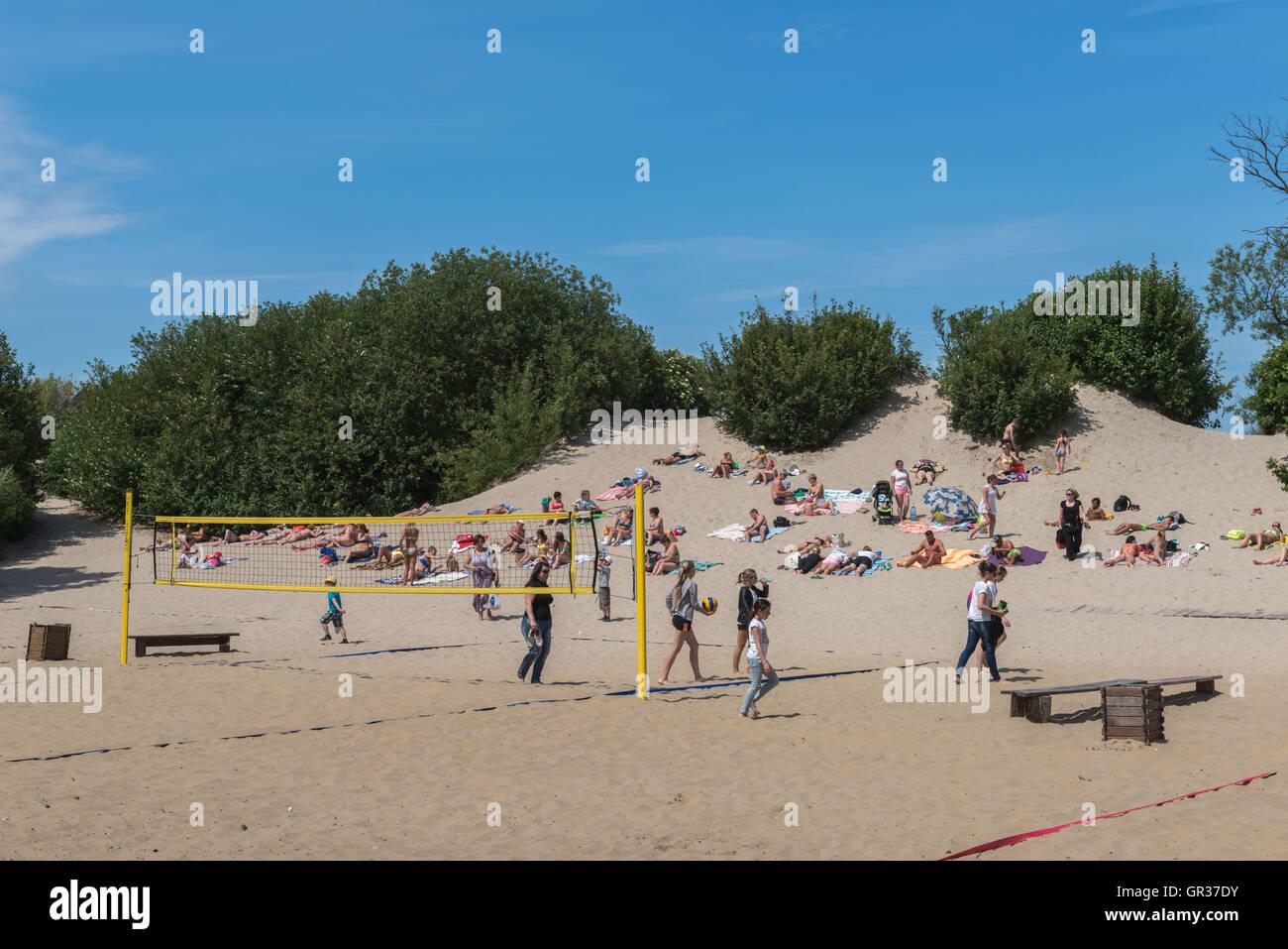 Sunbathing on a dune at the Baltic  seaside-resort  Zelenogradsk, ex Cranz, Kaliningrad Region, Russia, - Stock Image