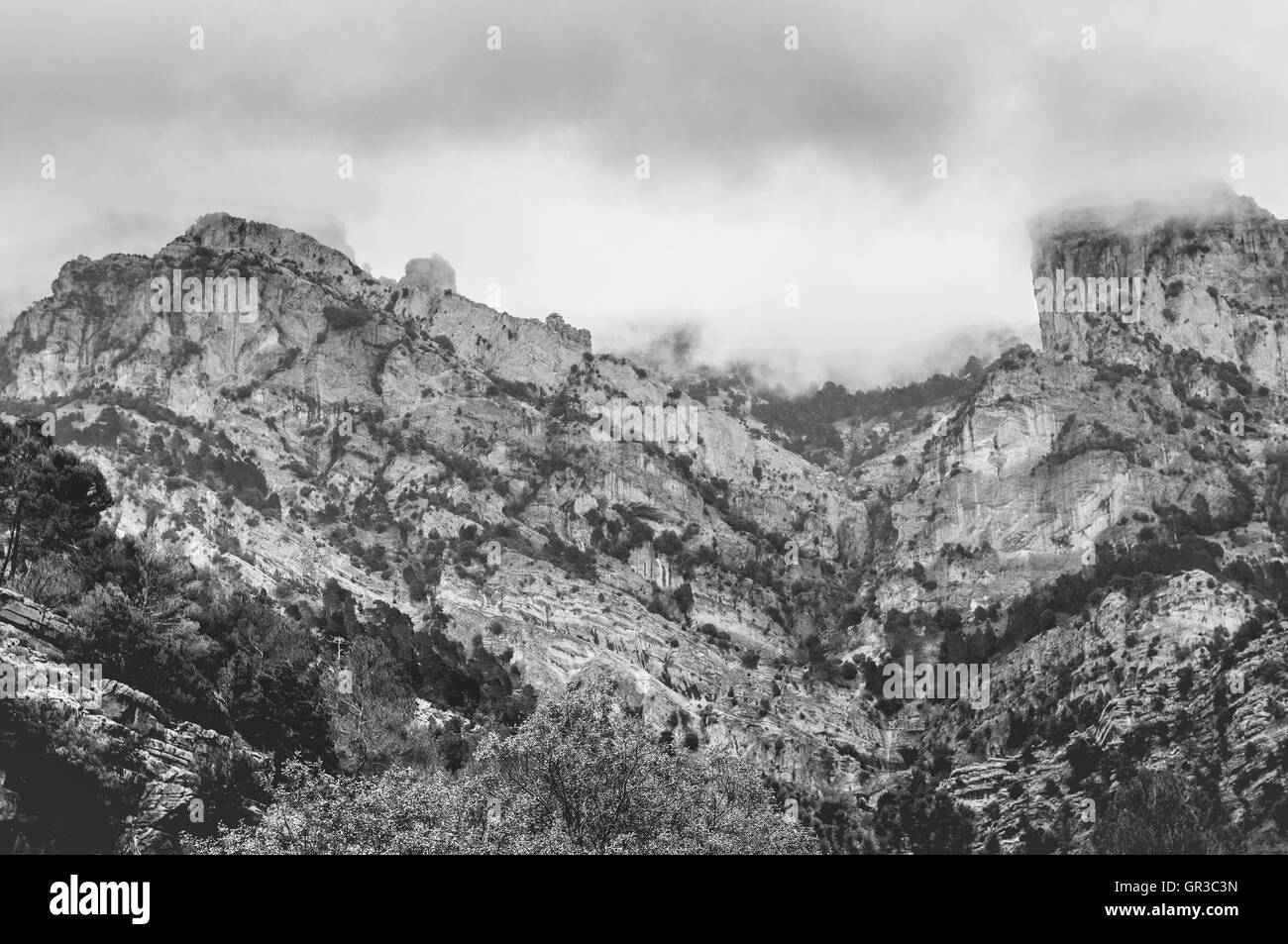 Black and white cloudy mountains in Cazorla, Jaen, Spain - Stock Image
