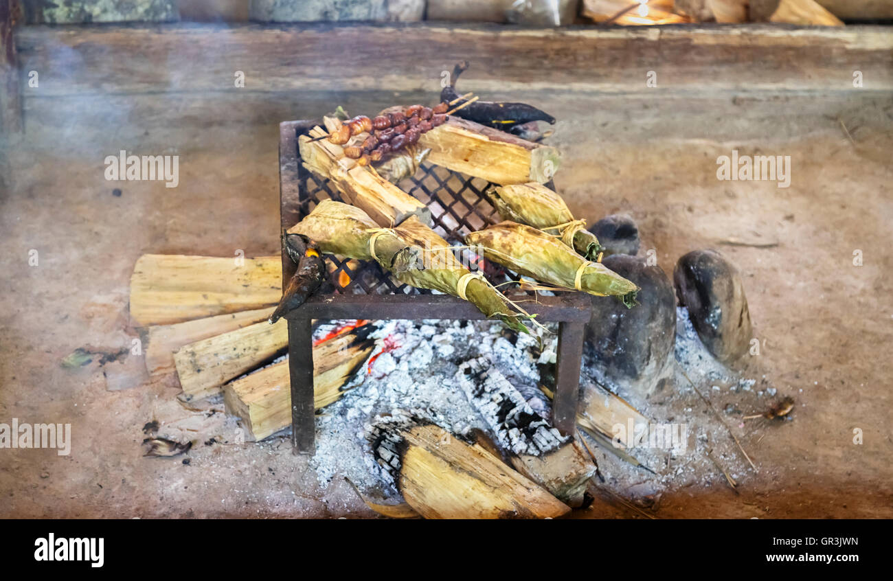 Food being cooked over an open wood fire at the Pilchi Community on the Napo River (an Amazon tributary), Ecuador, - Stock Image