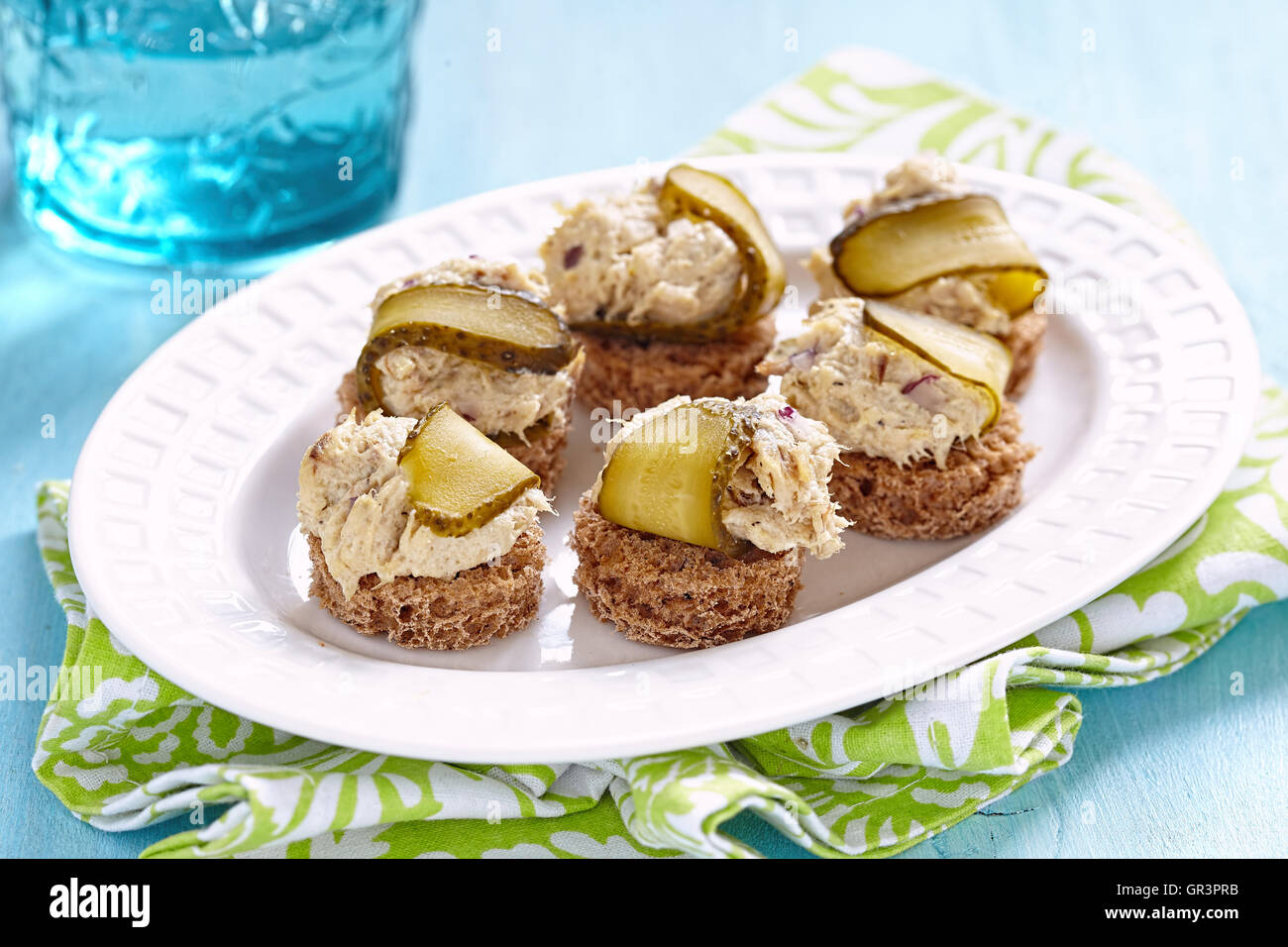Canapes with fish pate and pickle. Party food - Stock Image