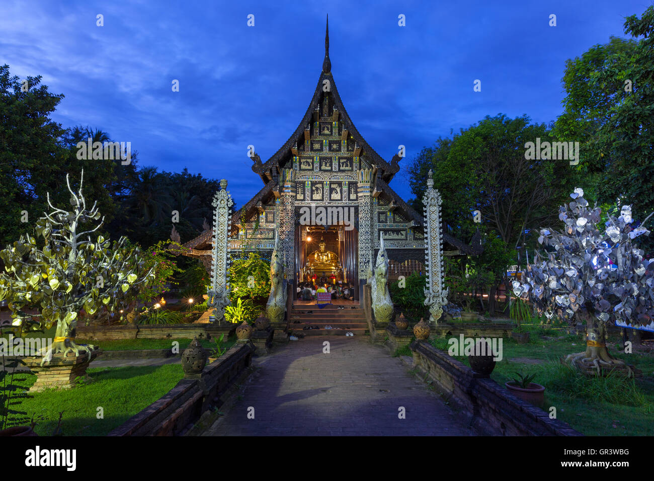 Wat Lok Molee at dusk, one of the oldest temples in Chiang Mai, Thailand - Stock Image