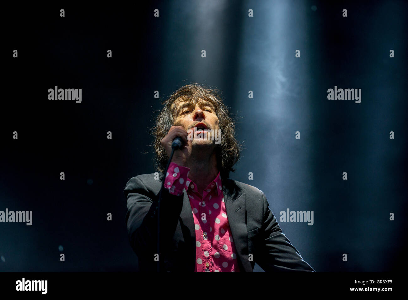 Bobby Gillespie lead singer of Primal Scream preforming ahead of Massive Attack on The Downs in Bristol, September - Stock Image