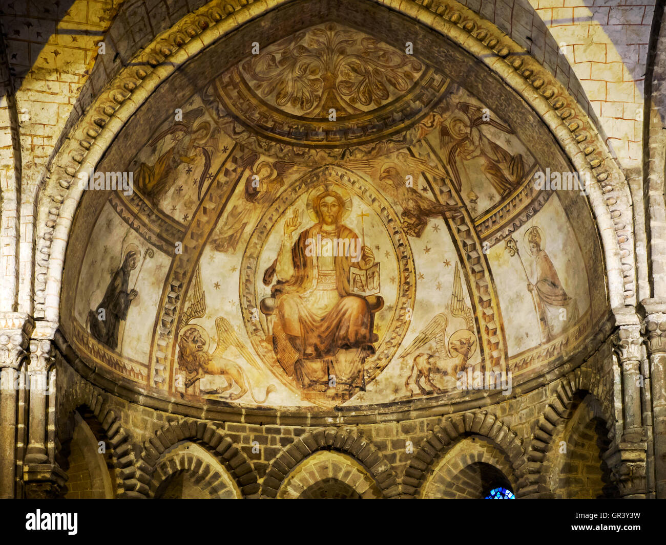 Mural in the 12th century Chapel of St Crepin (St Crispin) in the Basilique d'Evron church, a medieval masterpiece. - Stock Image