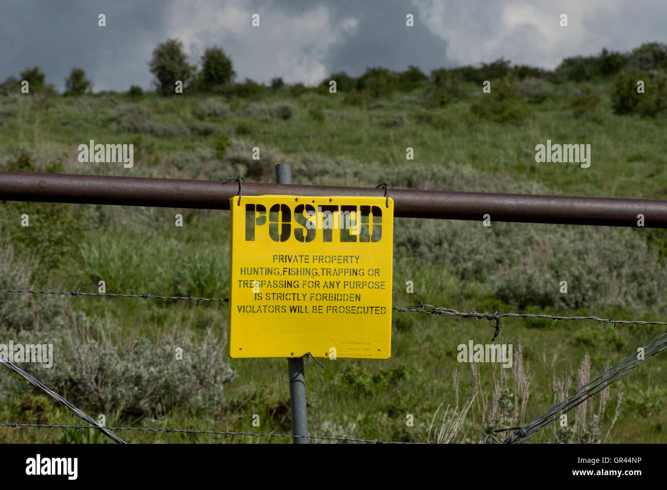 No trespassing sign on private land - Elmore County, ID - Stock Image