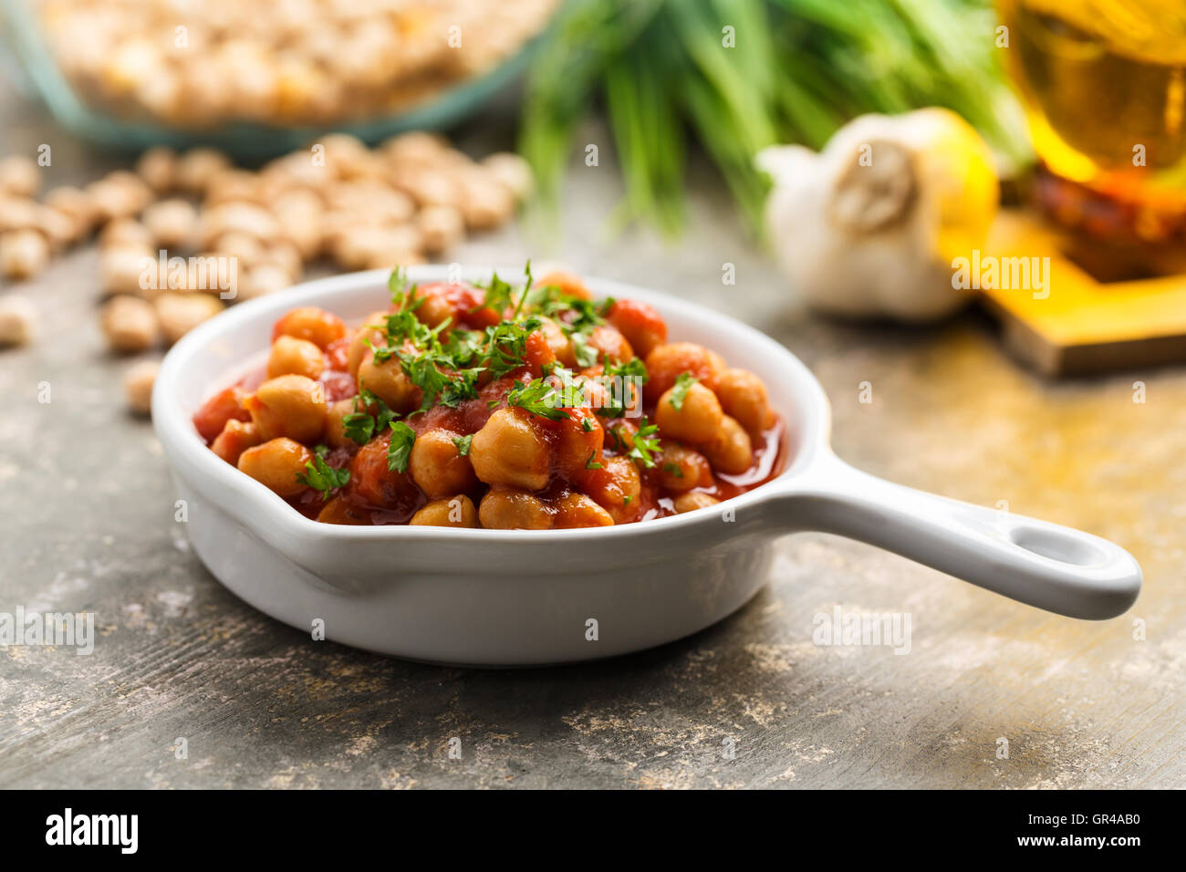 Indian curry with chickpeas and tomato sauce. - Stock Image
