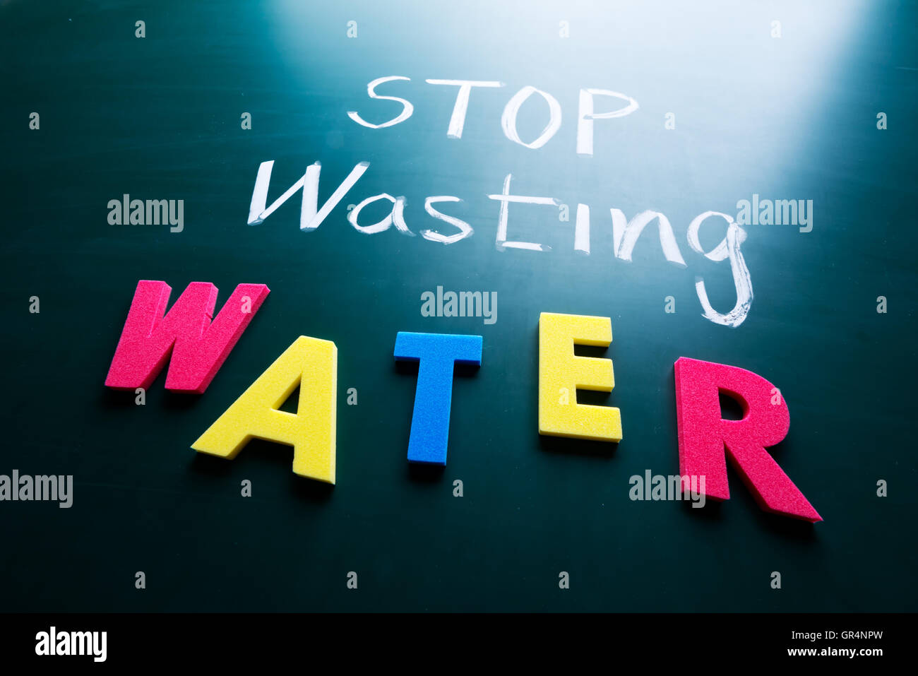 Stop wasting water concept - Stock Image