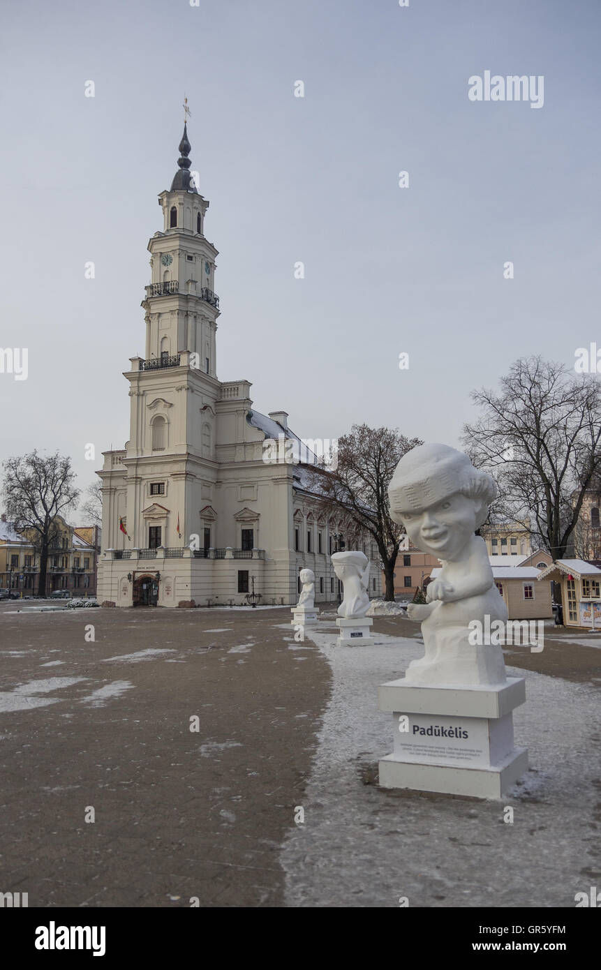 Kaunas, Lithuania - January 3, 2016: Town hall and town hall square with christmas market and statue. - Stock Image