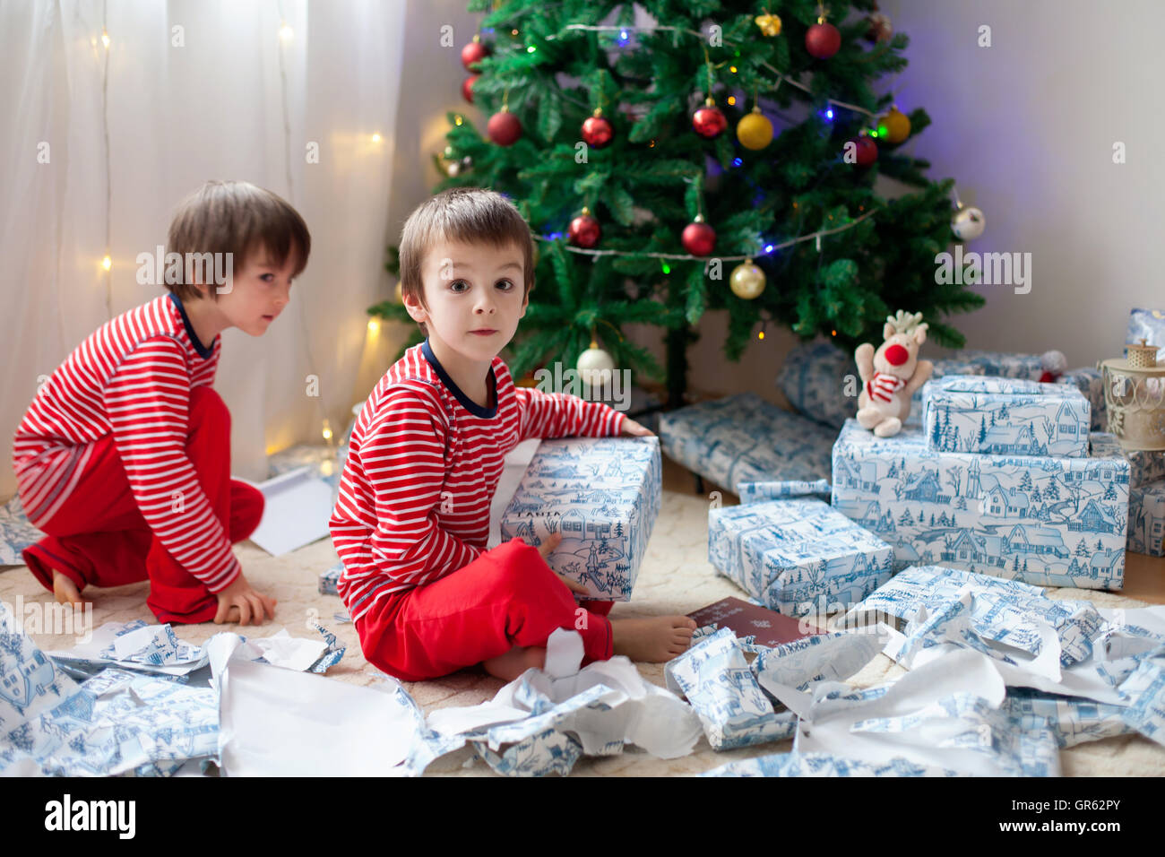 Boy Opening Christmas Presents Stock Photos & Boy Opening Christmas ...