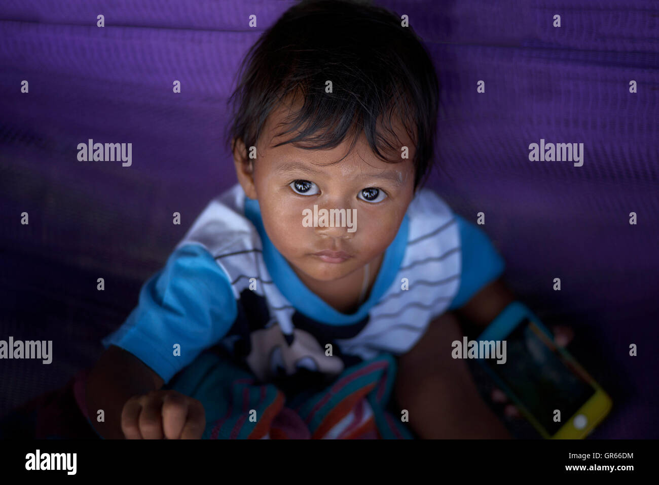 Looking down at a wide eyed child. Thailand S. E. Asia - Stock Image