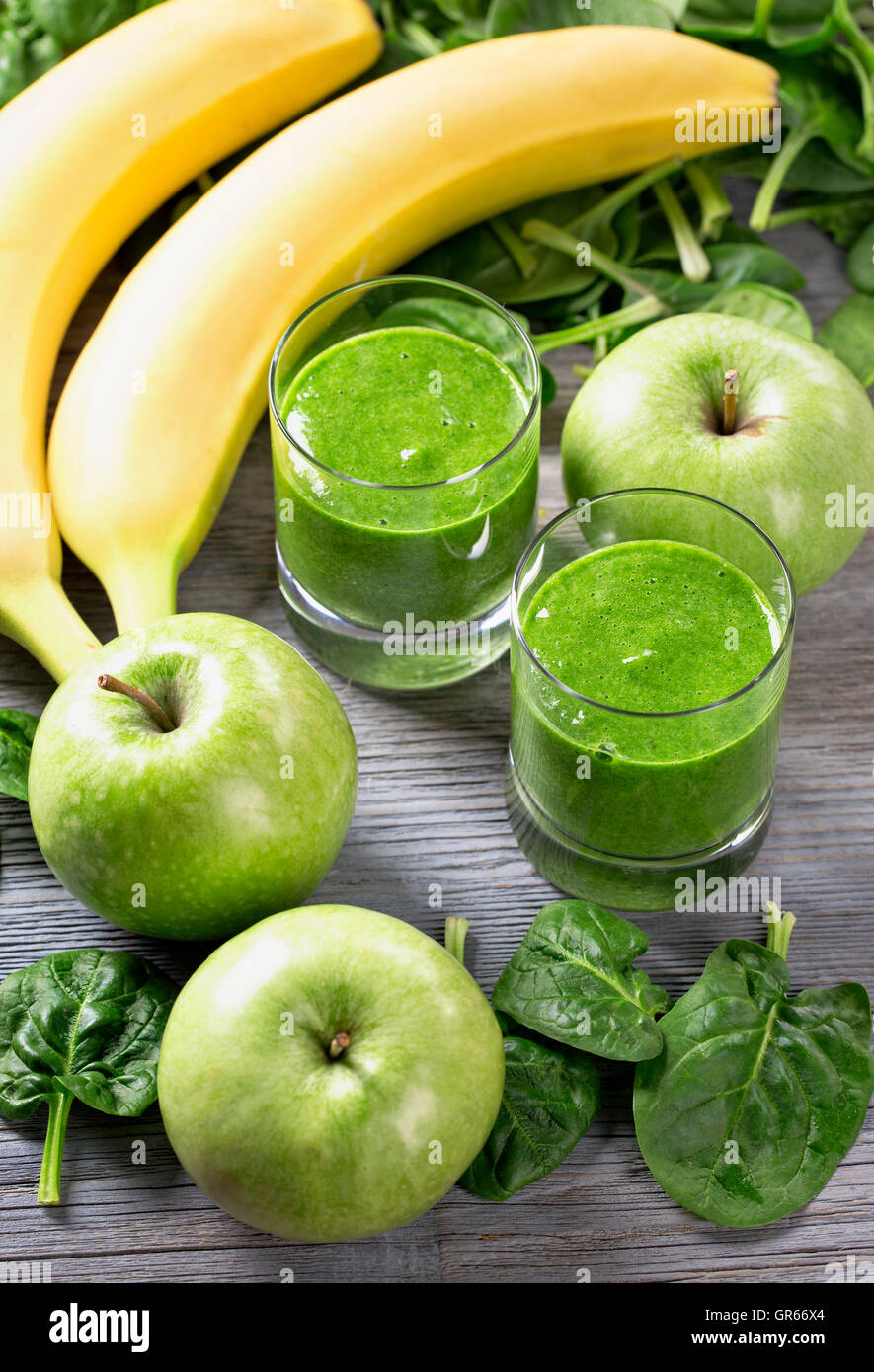 Green smoothie with spinach and banana in glass Stock Photo