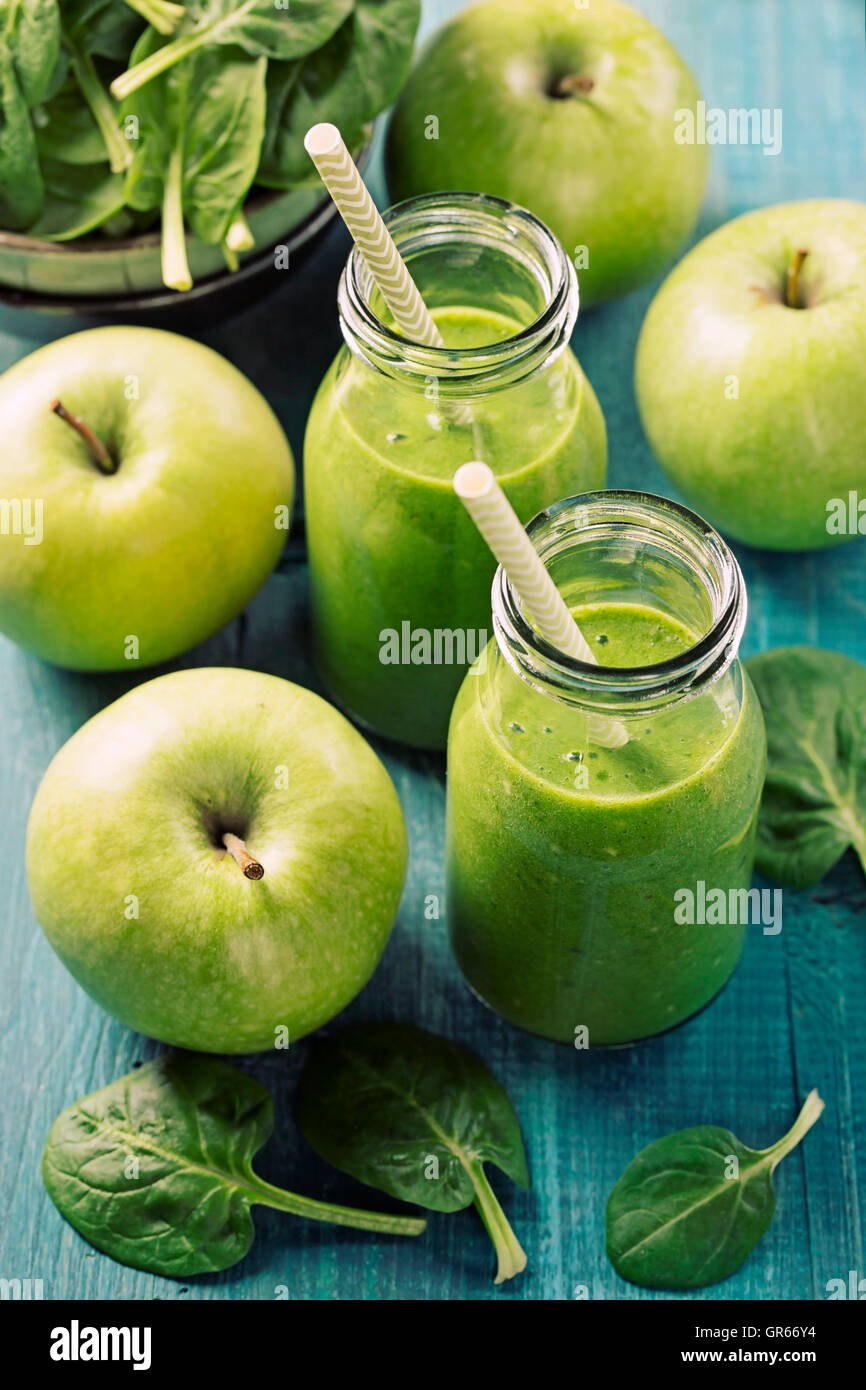 Green smoothie with spinach in glass - Stock Image