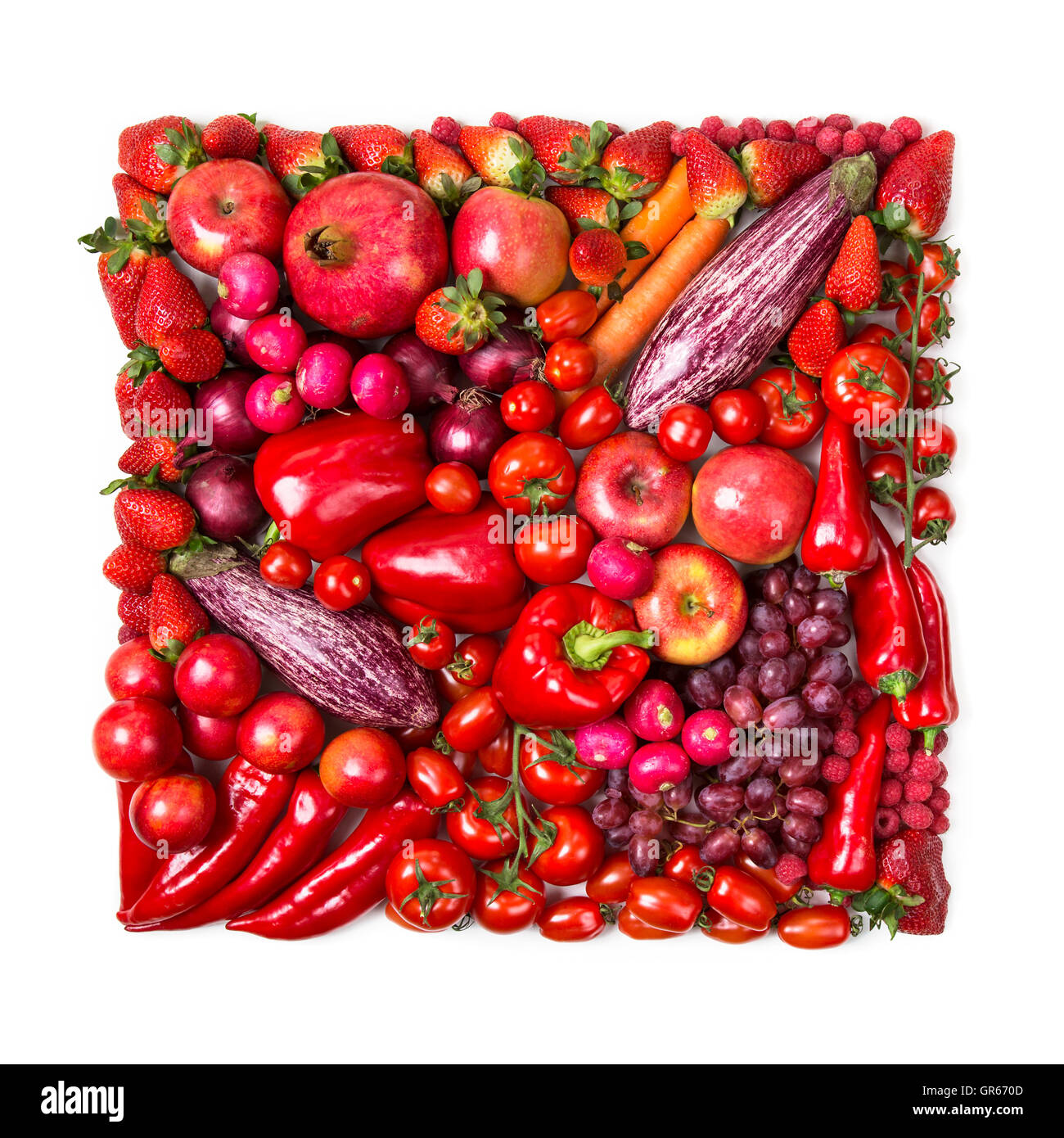 Square of red fruits and vegetables isolated on a white background - Stock Image