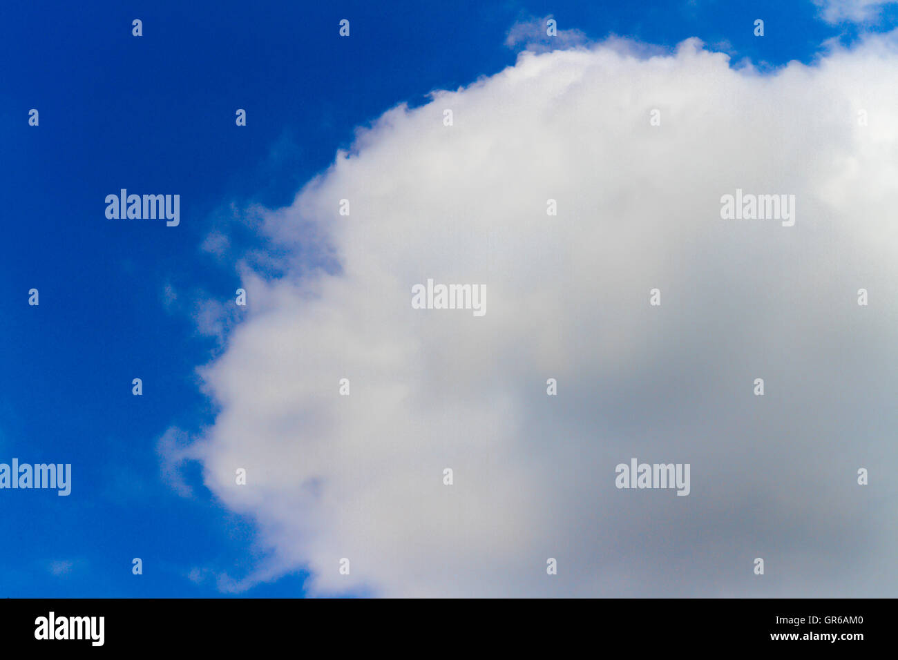 White Cloud Infront Of Blue Sky In Summer - Stock Image
