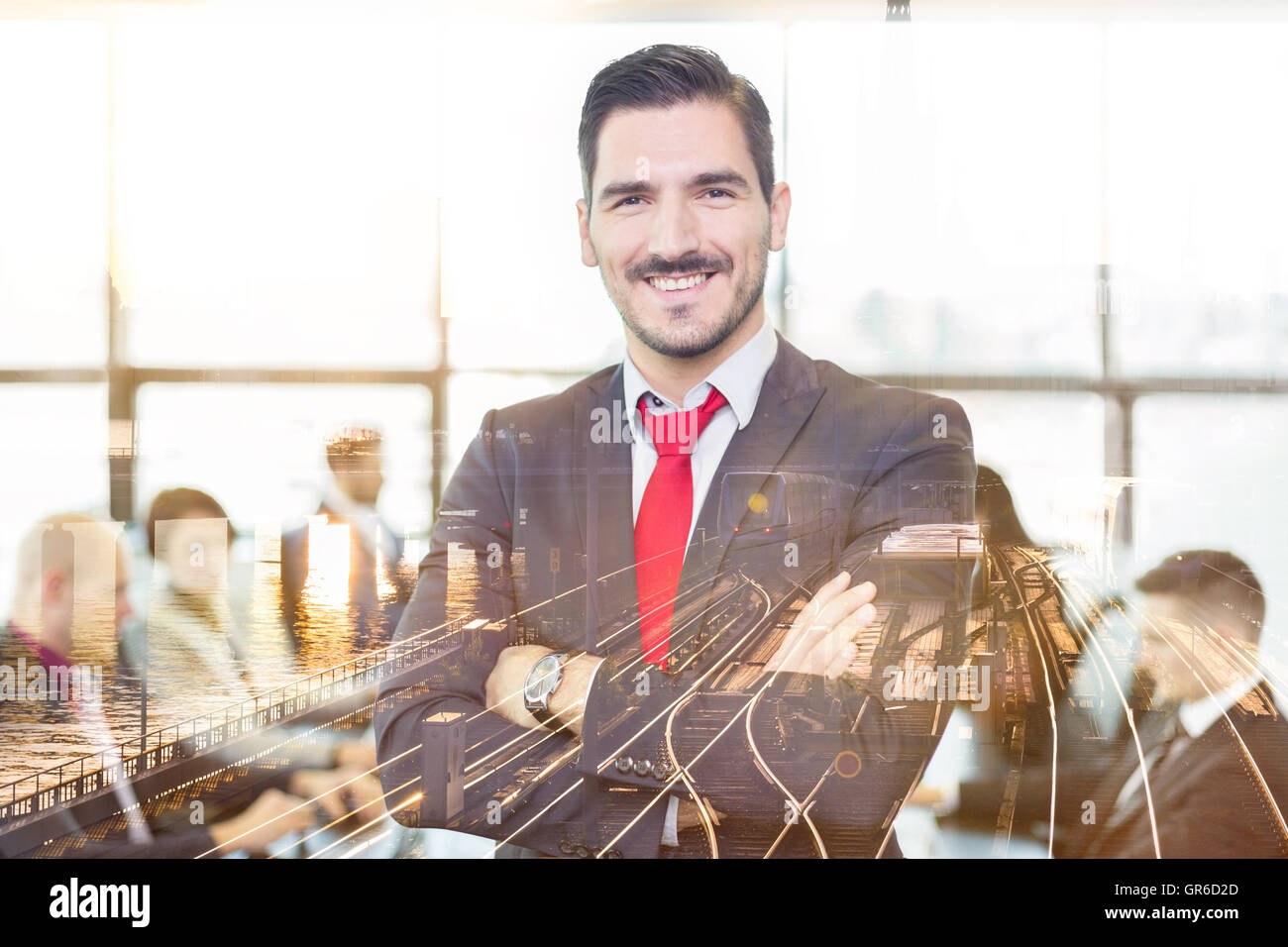 Team leader with coworkers in office. - Stock Image