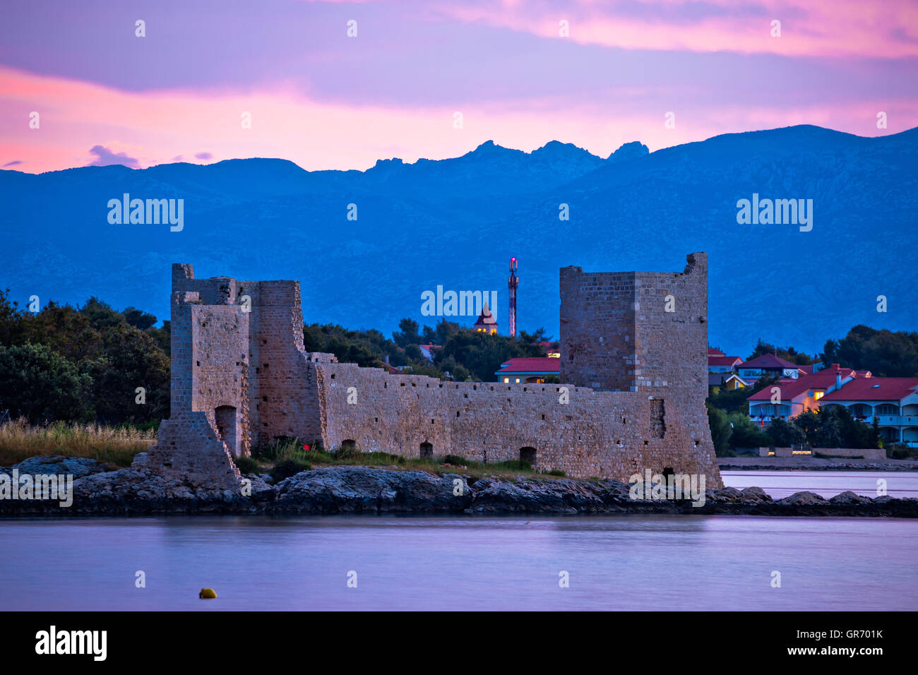 Island of Vir dawn view, fortress and Velebit mountain, Dalmatia, Croatia - Stock Image