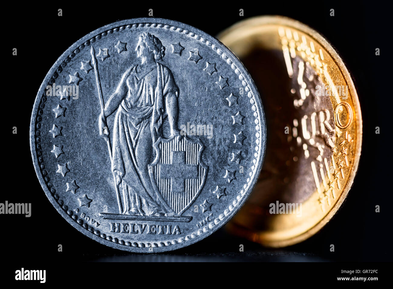 Swiss Franc And Euro Coin - Stock Image