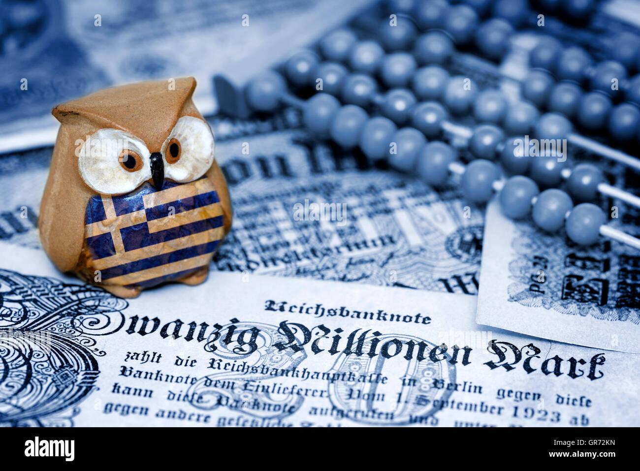 Greek Owl Sitting On Old German Inflation Money, German Reparations - Stock Image