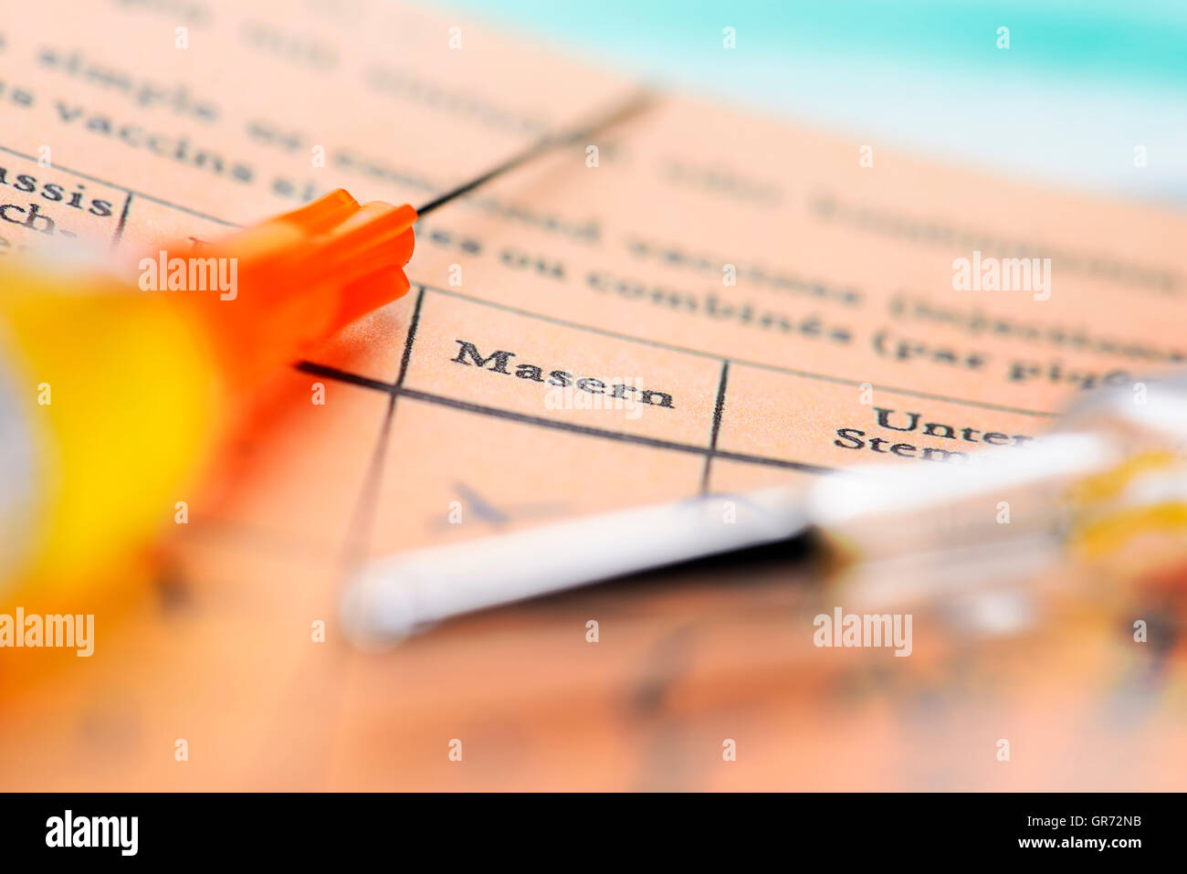 Syringe And Vaccination Card, Measles Vaccination - Stock Image
