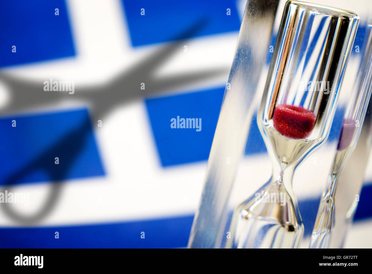 Flag Of Greece, Hourglass And Scissors, Greek Debt Cut - Stock Image
