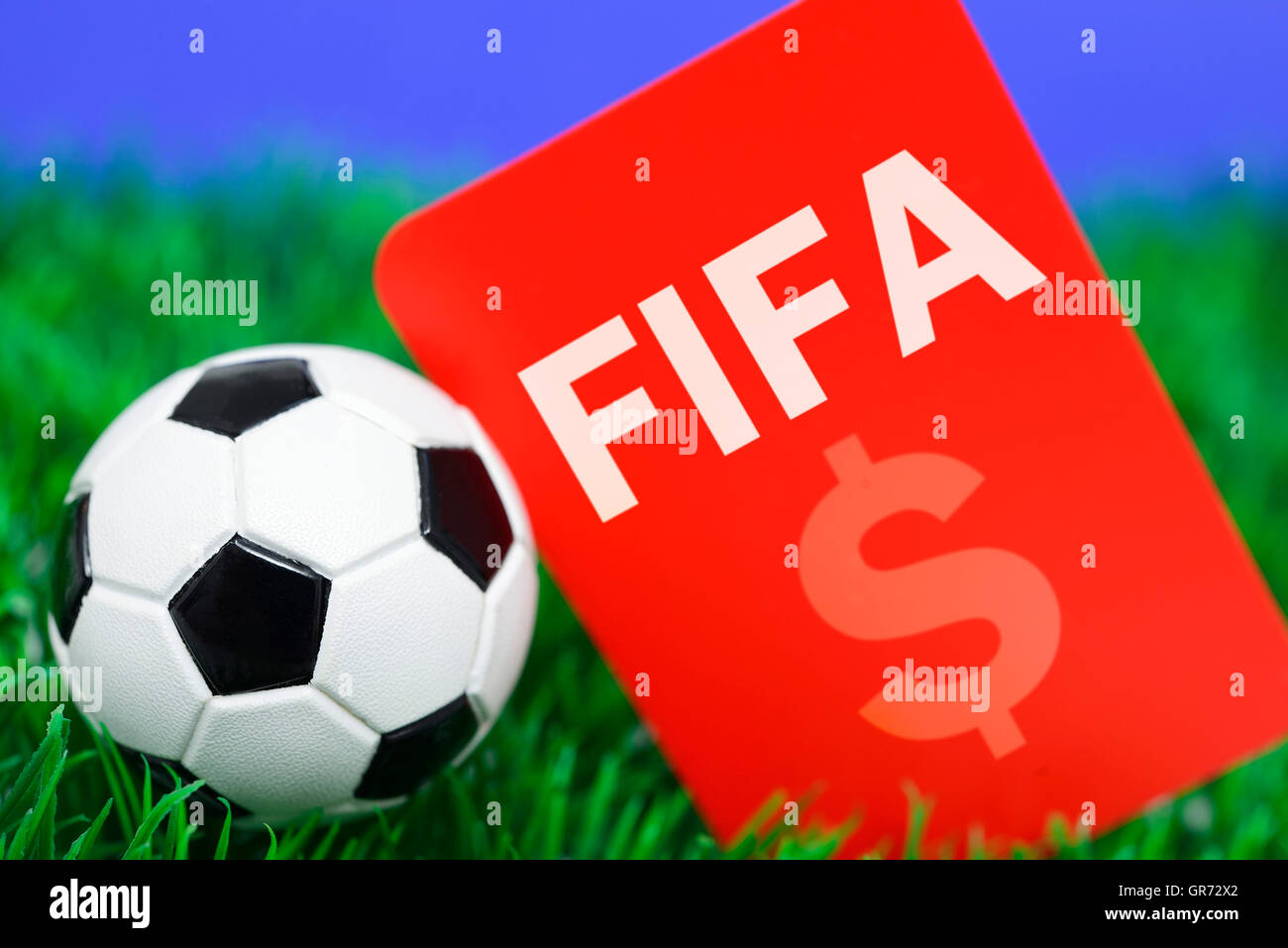 Miniature Soccer Ball And Red Card, Fifa Scandal - Stock Image