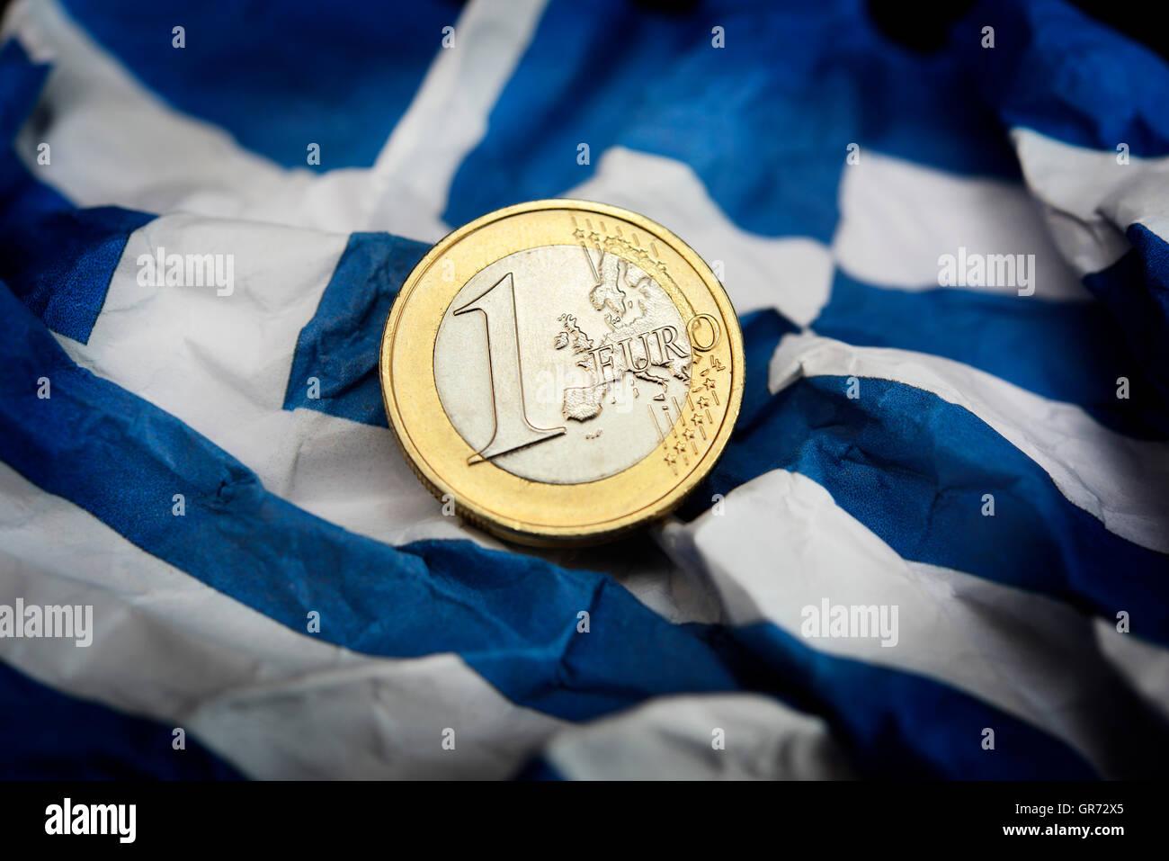 Euro Coin On Flag Of Greece, Debt Crisis - Stock Image