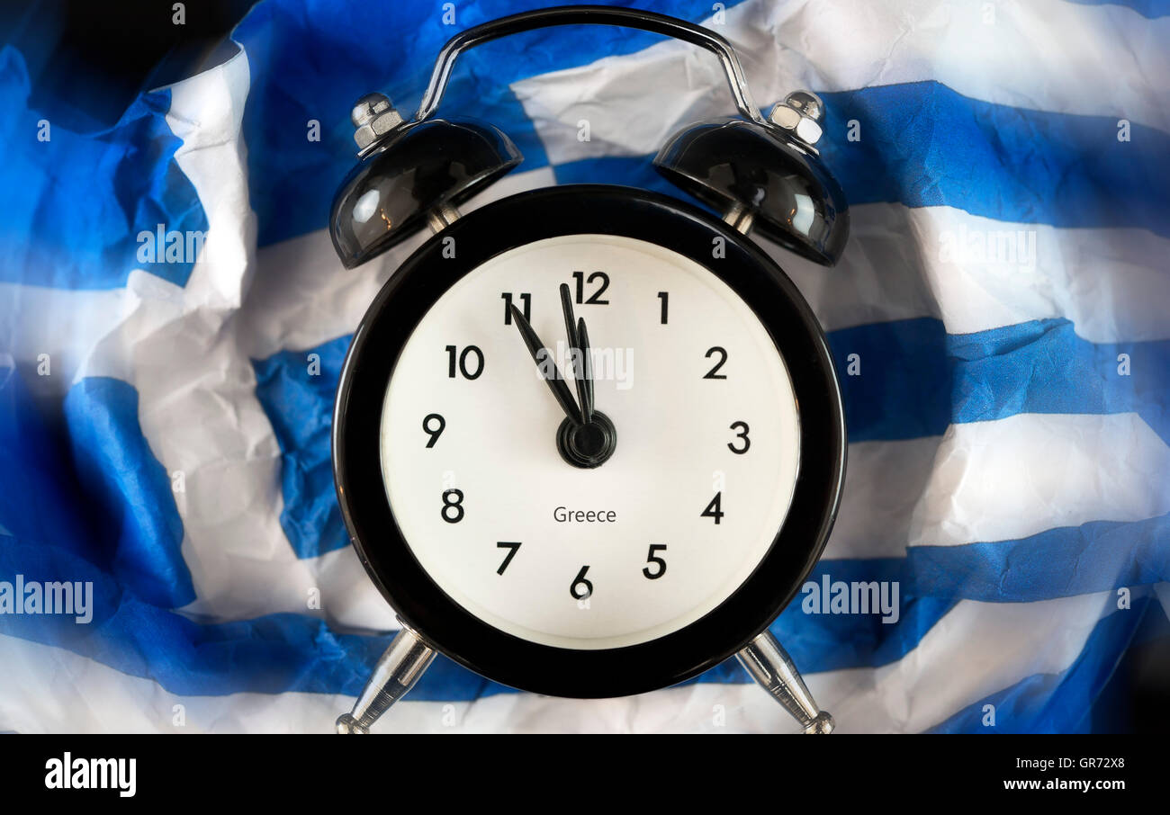Alarm Clock In Front Of Flag Of Greece, Debt Crisis - Stock Image