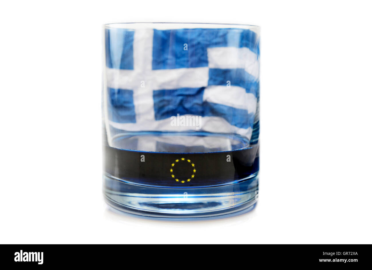 Empty Glass And Flag Of Greece, Debt Crisis Stock Photo