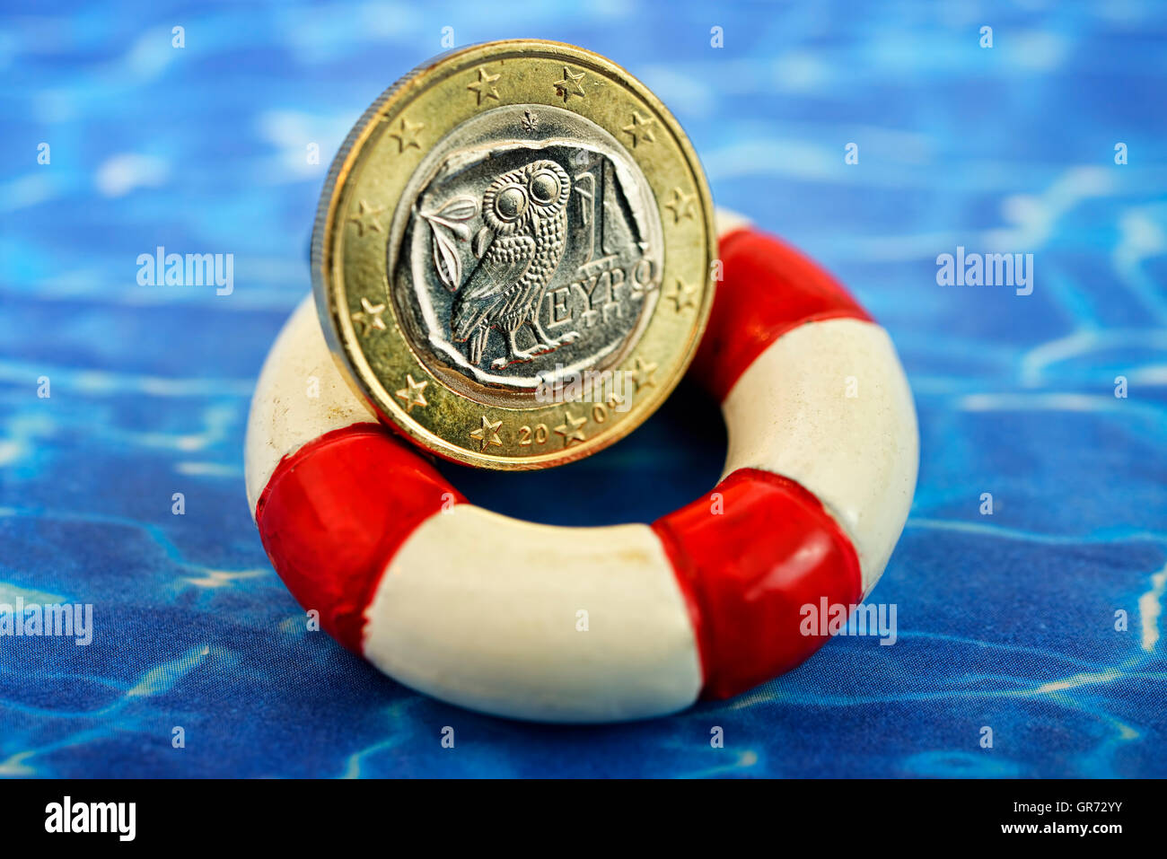 Greek Euro Coin On A Life Saver, Greek Bailout Package - Stock Image